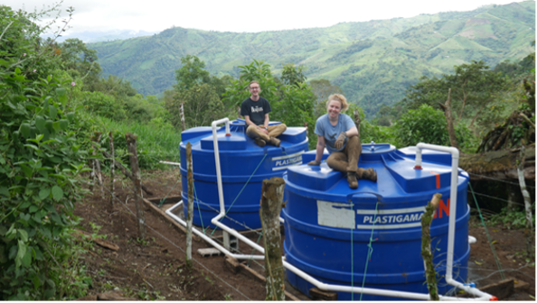 Steve Laudage (Pratt & Whitney) and Maeve Carlson (Wright-Pierce) top the newly installed water storage tanks above El Progreso, Ecuador.