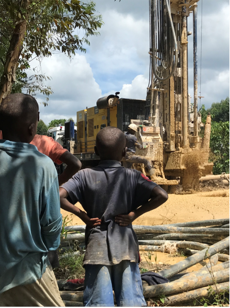 Community observing the drilling of a water supply well in the Lwengo District, Nakenyi, Uganda.