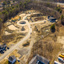 Aerial view of a construction site for Clover Way, a subdivision in West Falmouth