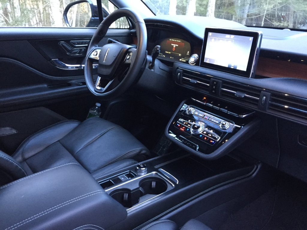 """While interior controls are intuitive to use, the piano-key layout on the dash for the automatic transmission takes some getting used to, and the voice-activated push-button on the steering wheel rim is directly where your left hand will be when utilizing the """"10-and-2"""" position."""