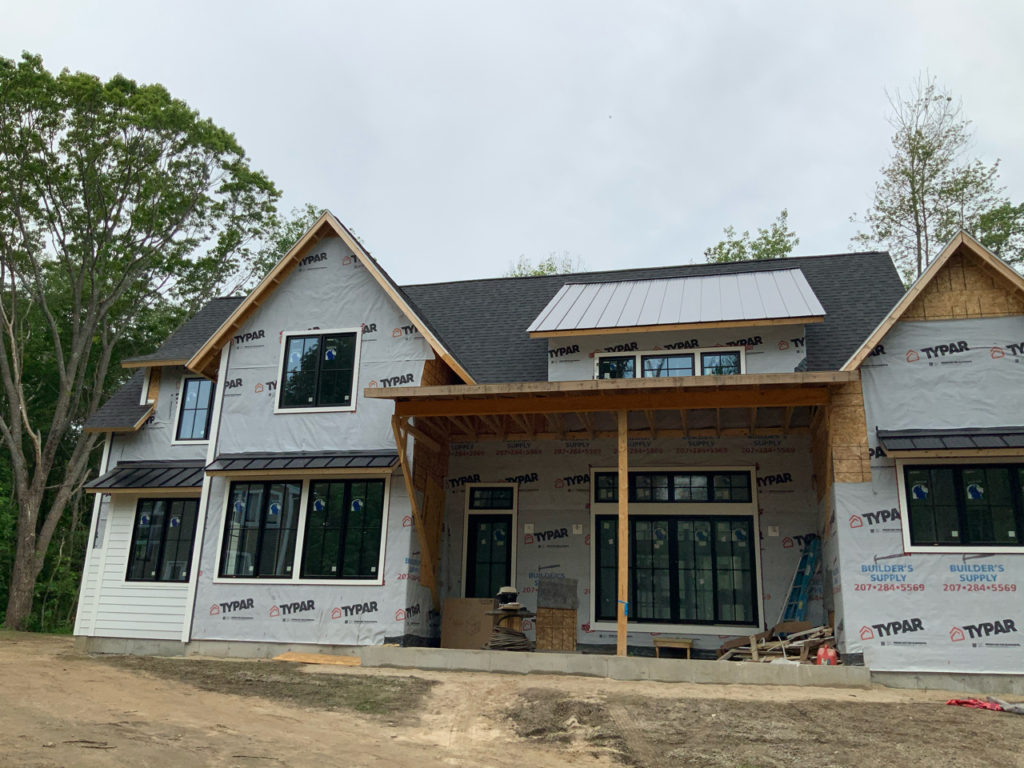 A spec home nearing completion on Shore Rd. in Cape Elizabeth, developed by GenX and sold for $1.7 million. It is one of more than 15 properties that GenX has under construction throughout Greater Portland.