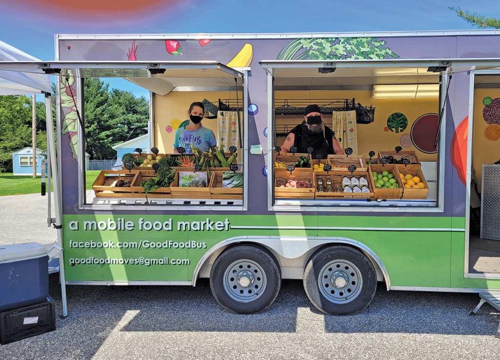 Good Food Bus market leaders Sophia Garmache and Jay Fiori are ready to help customers pick out their purchases during a market day this past summer.