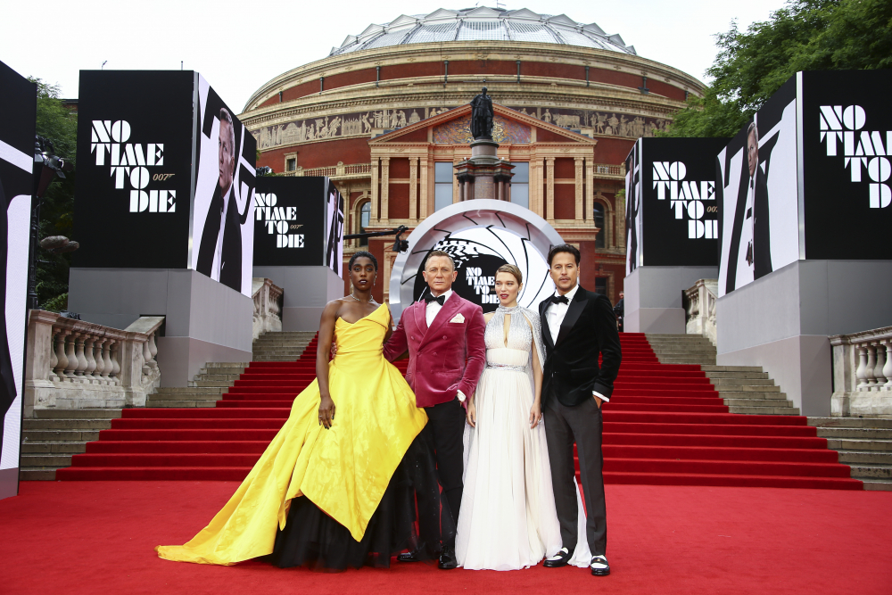 Lashana Lynch, from left, Daniel Craig, Lea Seydoux and Cary Joji Fukunaga arrive for the world premiere of the new film from the James Bond franchise, 'No Time To Die', in London on Sept. 28.
