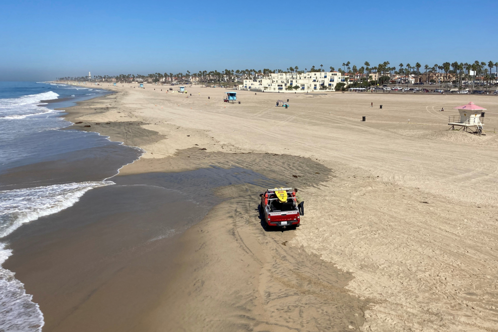 Few people visit Sunday, a week after the ocean was closed to surfing and swimming due to an offshore pipeline leak in Huntington Beach, Calif.