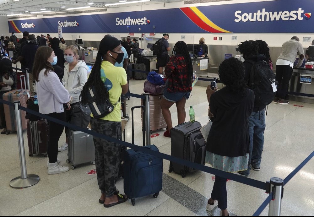 Passengers wait in line at the Southwest Airlines ticket counter at Fort Lauderdale Hollywood International Airport, on Monday.