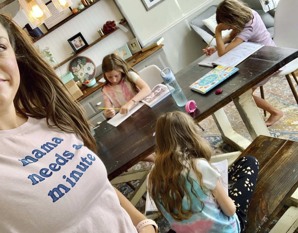Amber Cessac takes a selfie as her daughters do their homework at their home in Georgetown, Texas, on Sept. 9. A year and a half in, there is still the exhaustion of worrying about exposure to COVID-19 itself, and the policies at schools and day cares. The spread of the more infectious delta variant, particularly among people who refuse vaccinations, has caused a big increase in infections in children. But there's also COVID exposures and illnesses – and even minor colds – at schools and day cares that mean children get sent home, forcing parents to scramble for child care.