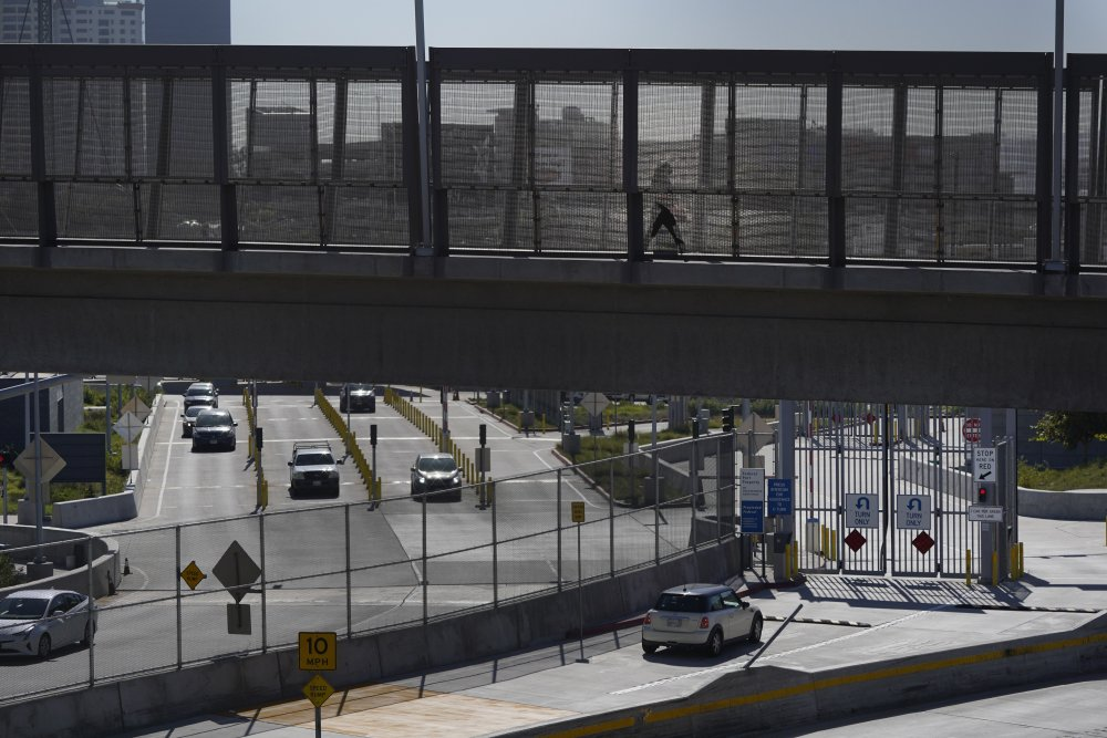 A few cars make their way north to cross into the United States from Tijuana, Mexico, Wednesday at the San Ysidro Port of Entry in San Diego.
