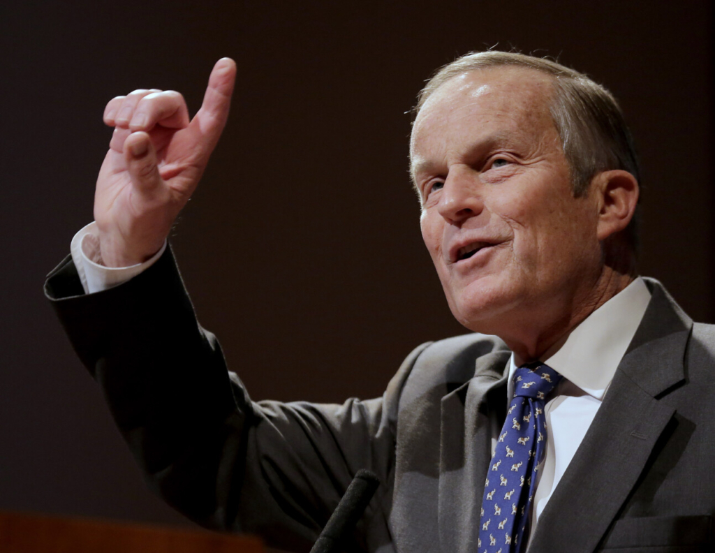 """FILE - In this Nov. 3, 2012, file photo, Republican U.S Senate candidate Todd Akin addresses supporters during a campaign event in Kansas City, Mo. Akin, whose comment that women's bodies have a way of avoiding pregnancies in cases of """"legitimate rape"""" sunk his bid for the U.S. Senate and became a cautionary tale for other GOP candidates, has died. He was 74. (AP Photo/Charlie Riedel, File)"""